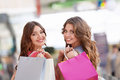 Young women girls with bags in a store Stock Image