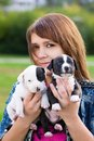 Young Women Holding Two Puppies Royalty Free Stock Images