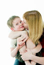 Young women kisses the son Stock Image