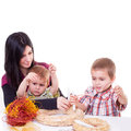 Young women with a little boys made advent wreath isolated Stock Photography