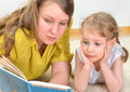 Young women little girl reading book Royalty Free Stock Image