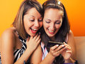 Young women looking at a cellphone Royalty Free Stock Photo