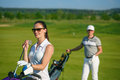 Young women and men playing golf Royalty Free Stock Photo