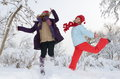 Young women outdoor in winter enjoying the snow happy Royalty Free Stock Photo