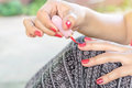 Young women are painted fingernail Royalty Free Stock Photo