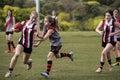 Females playing Australian Rules Football Royalty Free Stock Photo