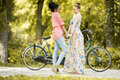 Young women posing by bicycle Royalty Free Stock Photo