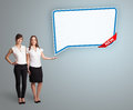 Young women presenting modern speech bubble copy space beautiful Royalty Free Stock Photo