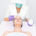 Young women receiving facial treatment salon Stock Images