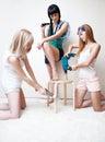 Young women repairing stool Stock Photography