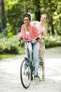 Young women riding on bicycle Royalty Free Stock Photo