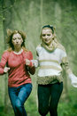Young women running Stock Image