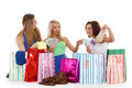 Young women with shopping bags happy money and sit on a white background sale Royalty Free Stock Image