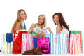 Young women with shopping bags happy money and sit on a white background sale Royalty Free Stock Photos