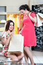 Young women shopping fashion in department store two female friends having fun while boutique or Royalty Free Stock Images