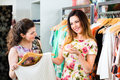 Young women shopping fashion in department store two female friends having fun while boutique or Stock Photography
