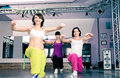 Young women sport dress aerobic zumba exercise Stock Images
