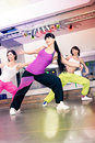 Young women sport dress aerobic zumba exercise Royalty Free Stock Images