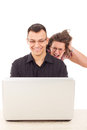 Young women spying on men because infidelity while he chatting over the internet cyber web Stock Photography