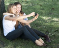 Young women taking a self portrait Royalty Free Stock Photo