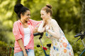 Young women talking by the bicycle Royalty Free Stock Photo