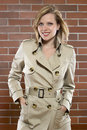 Young women in a trenchcoat Royalty Free Stock Images