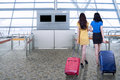 Young women walk in airport Royalty Free Stock Photo