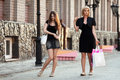 Young women walking on a city street two Royalty Free Stock Photo