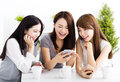 young women watching smart phone in living room