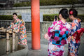Young women wearing traditional japanese kimonos at Fushimi Inari Shrine in Kyoto Royalty Free Stock Photo