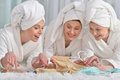 Young women wearing a white bathrobes Royalty Free Stock Photo