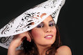 Young women in white paper hat Royalty Free Stock Photo