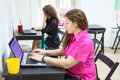 Young women working with laptops at desks in office Royalty Free Stock Photography