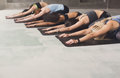 Young women in yoga class, half tortoise pose stretching Royalty Free Stock Photo