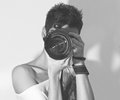 Young women's photographer's self portrait in black and white style Royalty Free Stock Photo