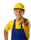 Young worker pointing at you and smile Royalty Free Stock Photos