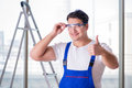 The young worker with safety goggles Royalty Free Stock Photo