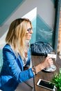 Young woman stiring coffee Royalty Free Stock Photo