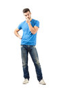 Young worried man thinking looking down full body length portrait isolated over white background Royalty Free Stock Images