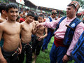 Young wrestlers greet a gypsy musician at the kirkpinar turkish oil wrestling festival in edirne in turkey prior to start of Stock Photo