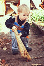 Young yard keeper little boy with a broom in hand cleaning your Royalty Free Stock Photography