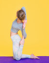 Young yogini woman stretching