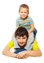 Younger years old boy playing sitting big brother Stock Image