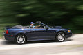 Younging man speeding in convertible young countryside sports car Royalty Free Stock Images