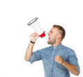 Youngman shouting through megaphone, Royalty Free Stock Photo
