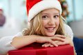 Youngster with gift portrait of cheerful girl red giftbox looking at camera on christmas evening Stock Photos