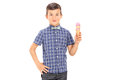 Youngster holding an ice cream cone isolated on white background Stock Images