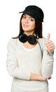 Youngster in peaked cap thumbs up teen black wearing earphones isolated on white Royalty Free Stock Photo