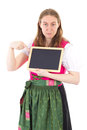 Youngster pointing to board in dirndl Royalty Free Stock Photo