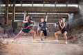 Youngsters in form practices grit exercises hangar Royalty Free Stock Photos